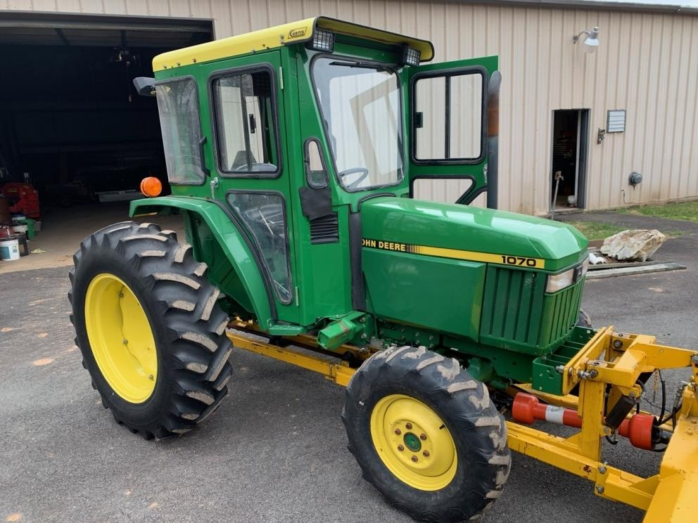 John Deere 1070 tractor, JD 430 loader, diesel, 4wd, Curtis cab, also with canopy, 809 hours, gear drive, 3 speed