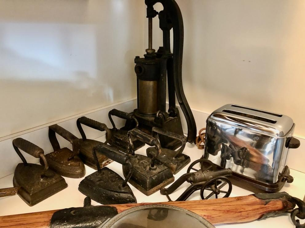 Vintage cistern pump, sad irons, toaster, cannon, and more