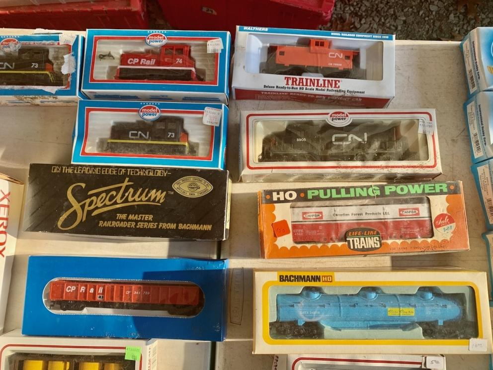 CN and CP Cabooses. Engine, Forest Products box car, oil tanker.