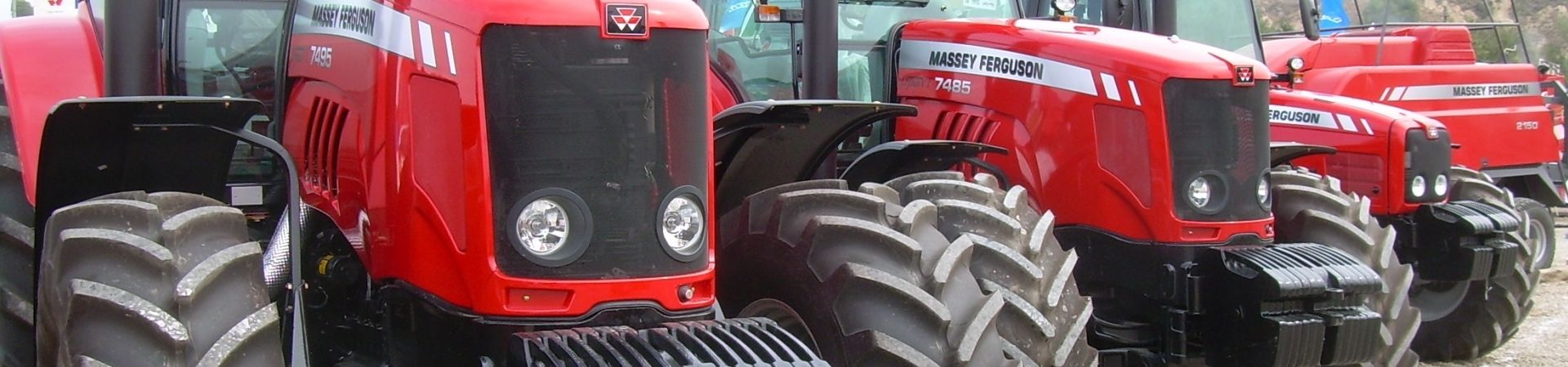 A line of red massey ferguson tractors
